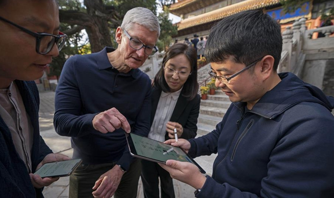 Apple's CEO Tim Cook visits Beijing