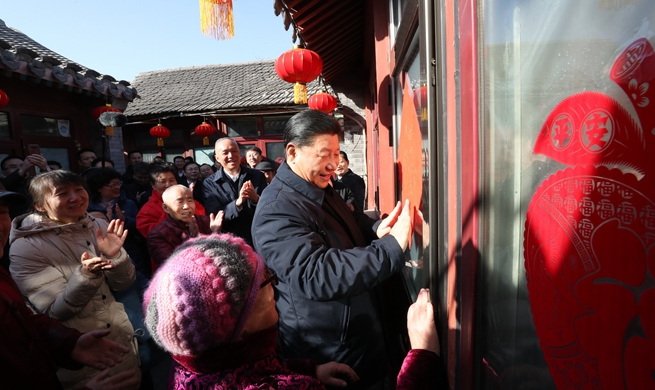 Xi visits cadres, residents in Beijing ahead of Spring Festival