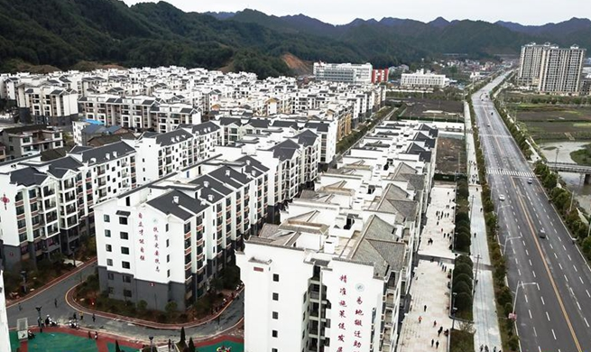 Households move into settlement for poverty relief relocation in China's Guizhou