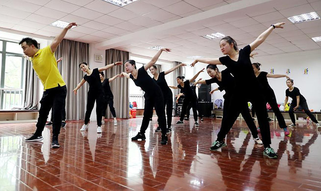 In pics: dance group composed of hearing-impaired people in Shanghai