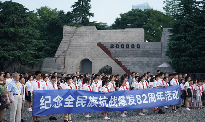 People commemorate anniv. of beginning of nationwide war against Japanese aggression in Nanjing