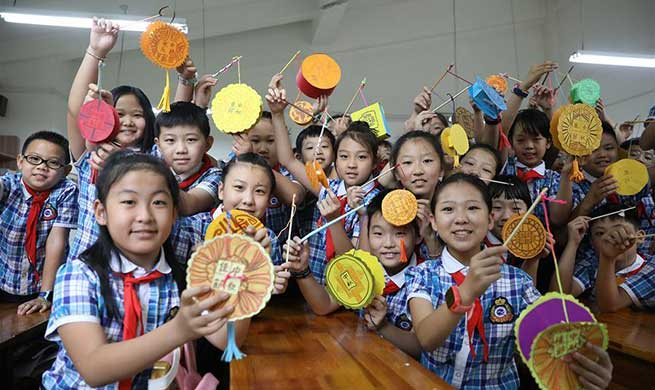 Students celebrate Mid-Autumn Festival in Shijiazhuang, China's Hebei