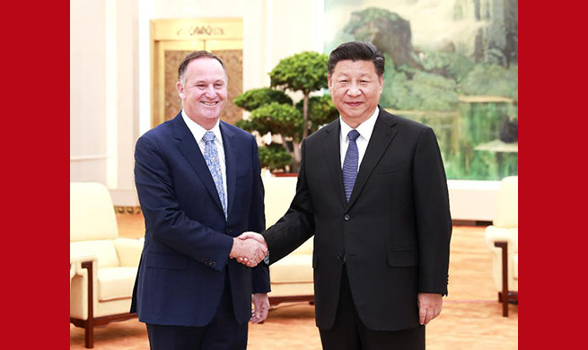 Chinese president meets former New Zealand PM John Key