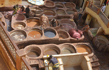 People work at Chaouwara Tannery in Morocco