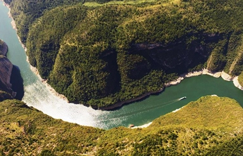 Autumn scenery of fish head-shaped river bend in SW China's Chongqing