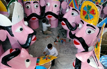 Workers prepare effigies of Demon King for upcoming Hindu festival Dussehra