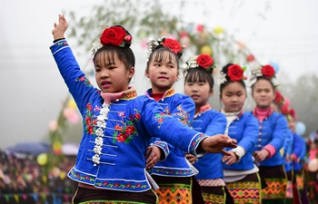 Miao people perform folk dance to celebrate Chinese Lunar New Year in China's Guizhou