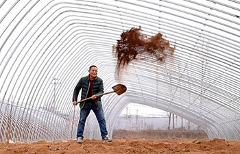 Farmers busy working in early spring across China
