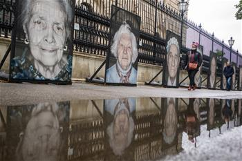Photo portraits of holocaust survivors in WWII shown in Vienna, Austria