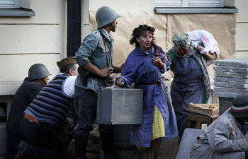 People take part in re-enactment of Warsaw Uprising in Poland