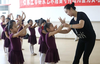 Children attend dancing class during summer vacation in north China's Hebei