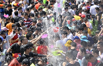 Water festival held in Baoting Autonomous County of Li and Miao in Hainan