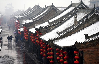 Snow scenery of Pingyao Ancient City in N China's Shanxi
