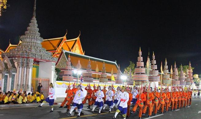 Thai monarch takes grandiose procession in Bangkok's olden quarters
