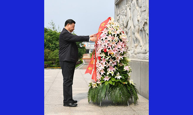 Xi Jinping lays floral basket at monument marking departure of Long March