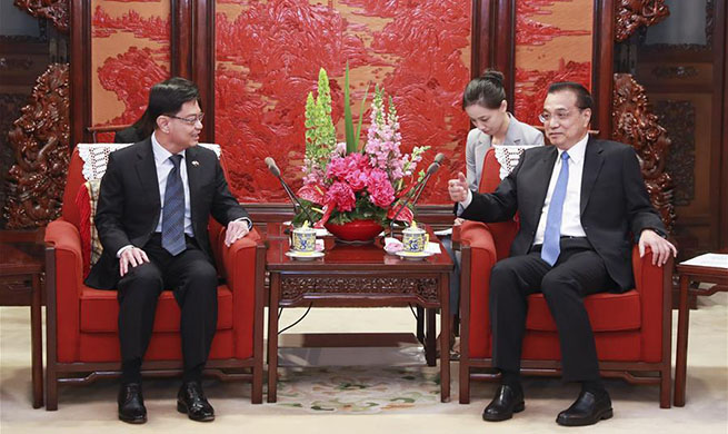 China to work with Singapore to safeguard rule-based multilateral trade system