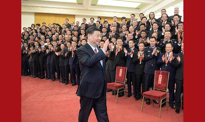 Xi meets model civil servants
