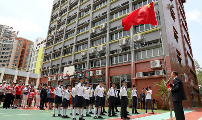 Association of Hong Kong Flag-guards holds flag raising ceremony at middle school