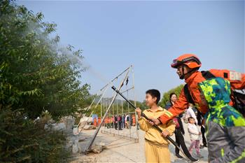 Campaign to publicize wildfire suppression launched to mark Int'l Day for Disaster Reduction