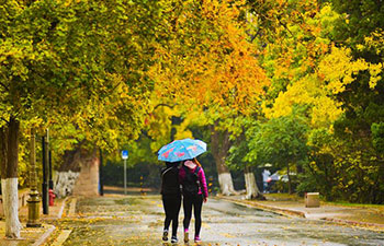 Tourists go sightseeing in rain at Badaguan scenic area in Qingdao