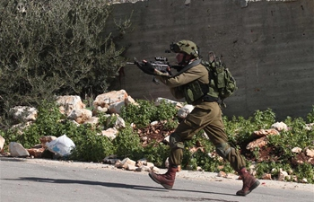 Israeli soldiers clash with Palestinian protesters near West Bank city of Nablus
