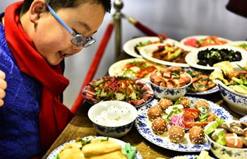 Spring Festival dishes made of polymer clay on exhibition in east China's Anhui