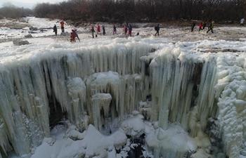 Amazing scenery of frozen waterfall in NE China's Heilongjiang