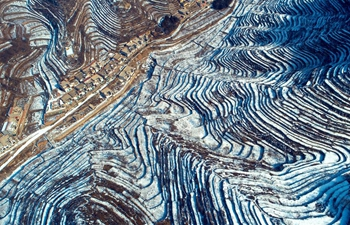 Aerial view of snow-covered terraced fields in north China's Hebei