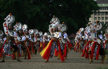 Dancers participate in Jathil mass dance at East Java, Indonesia