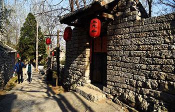 Tourists visit Shangjiushan Village in E China's Shandong