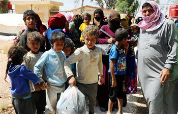 Batches of Syrian refugees return from Rukban camp