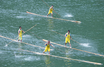 Villagers perform single bamboo drifting in China's Fujian