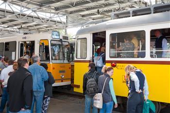 People visit 120-year-old Budafok Tram Depot in Budapest, Hungary