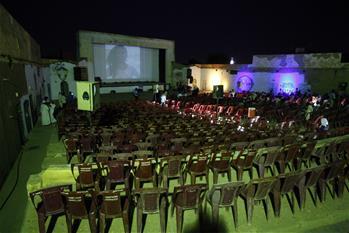 People watch movie in neighborhood of Khartoum North, Sudan