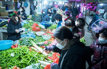 Citizens purchase vegetables at market in Wuhan