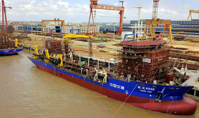 Two dredging vessels launched in east China's Jiangsu