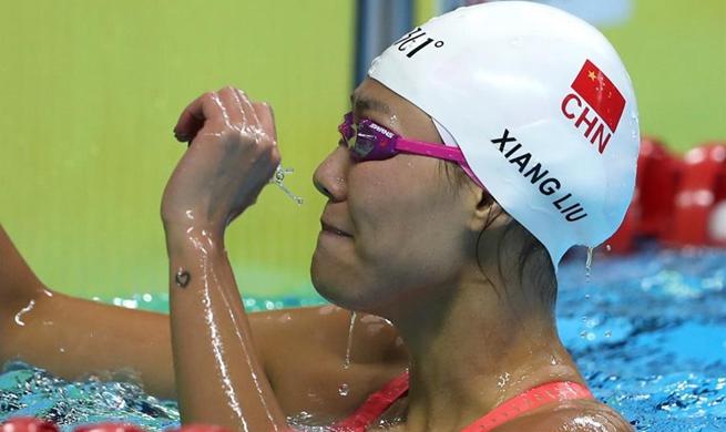 Star swimmer Liu Xiang breaks world record as China runs away with gold rush