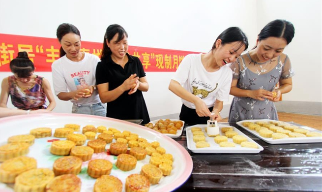 Chinese celebrate Mid-Autumn Festival by making mooncakes
