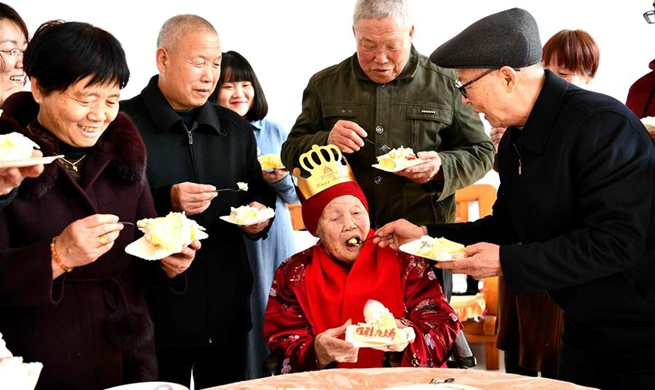 Centenarian celebrates her 105th birthday with family on 1st day of Chinese Lunar New Year