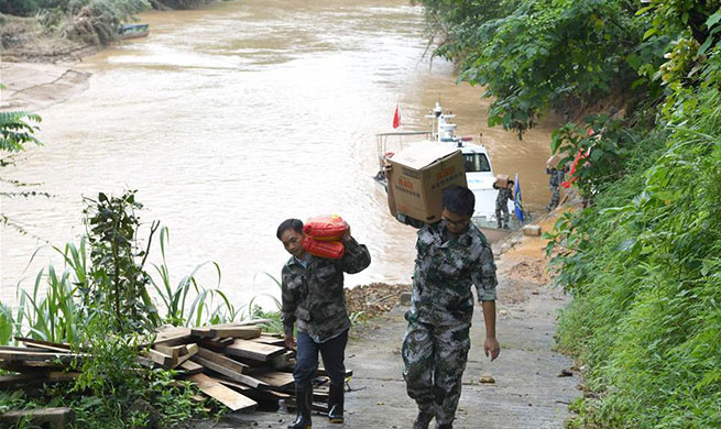 Villagers in flood-affected Guangxi receive disaster relief materials