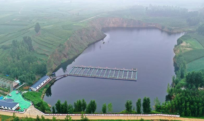 Abandoned mine transformed into fishpond in north China's Hebei