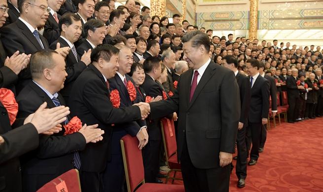 Xi meets model retired officials