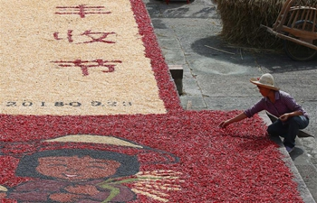 Villagers air crops at Chengkan Ancient Village in E China's Anhui