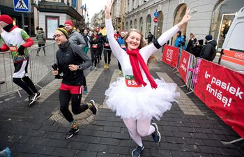 People attend annual Christmas Run in Vilnius, Lithuania