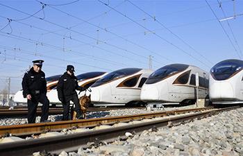 Railway policemen work to ensure safety for Spring Festival travel rush in Beijing