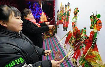 People enjoy folk arts during Chinese Lunar New Year holiday