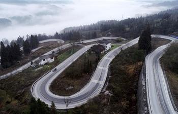 """Aerial view of """"Shidaguai"""" highway in Enshi, C China's Hubei"""