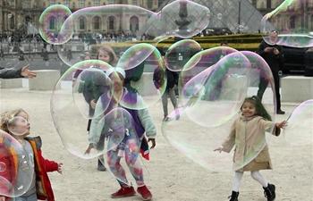 People enjoy leisure time in Paris