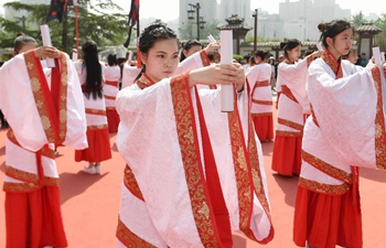 Students take part in traditional coming-of-age ceremony in NW China's Xi'an