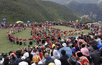 Local people attend ritual on Siguniang Mountain, SW China